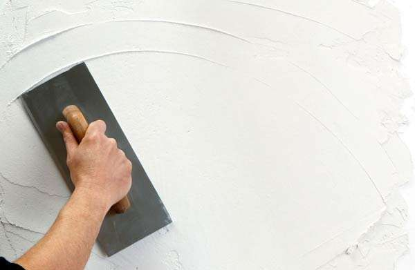 tiling onto plaster wall