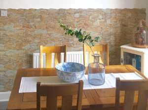 stone effect dining room feature wall