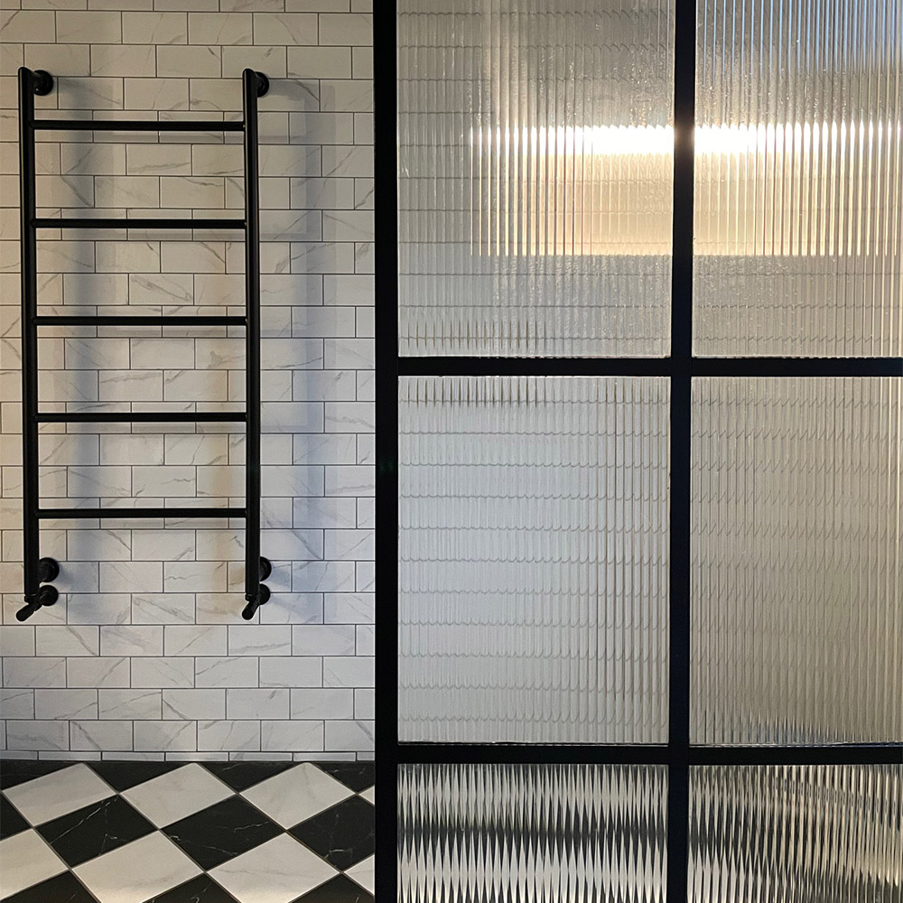 marble checkerboard flooring and white marble wall tiles with contemporary black accessories