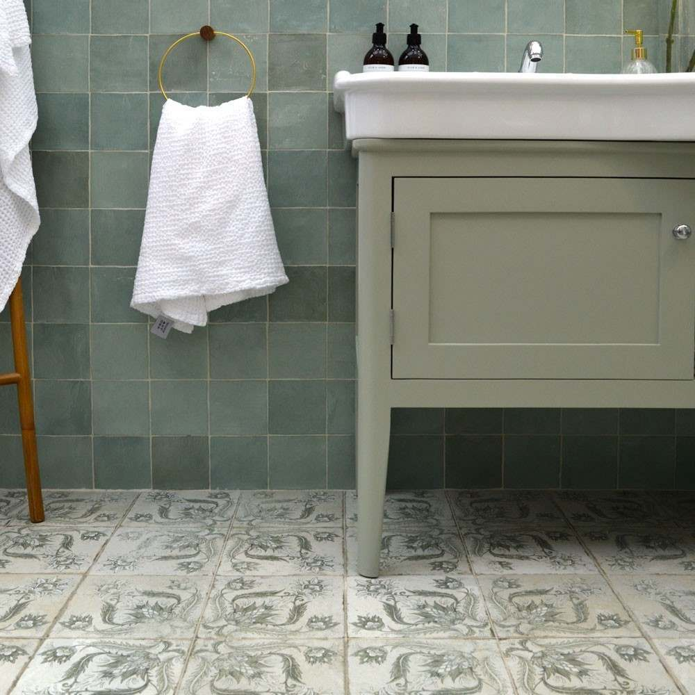 green statement tiles on the floor with square green tiles on the wall