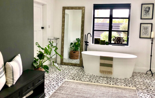 customers bathroom using pattered tiles and a stand alone bath