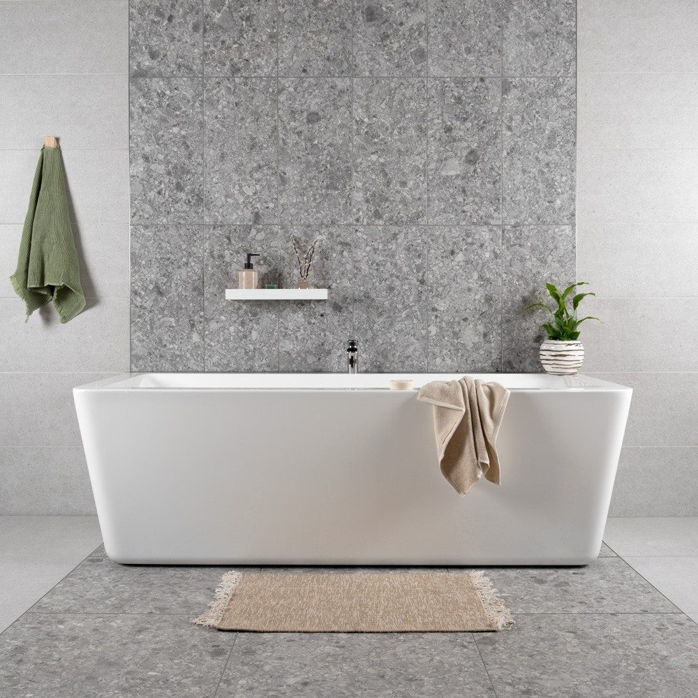 grey stone effect tiles matching on the walls and floors