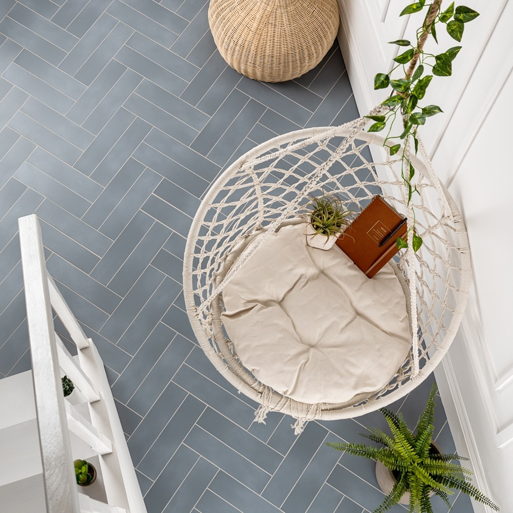Blue chatham tiles in a hallway with a swinging chair