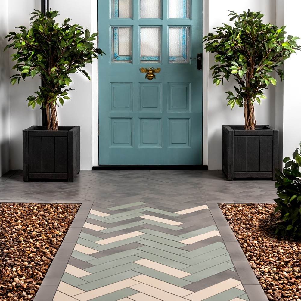 chatham tiles in the doorway in different colours in herringbone layout