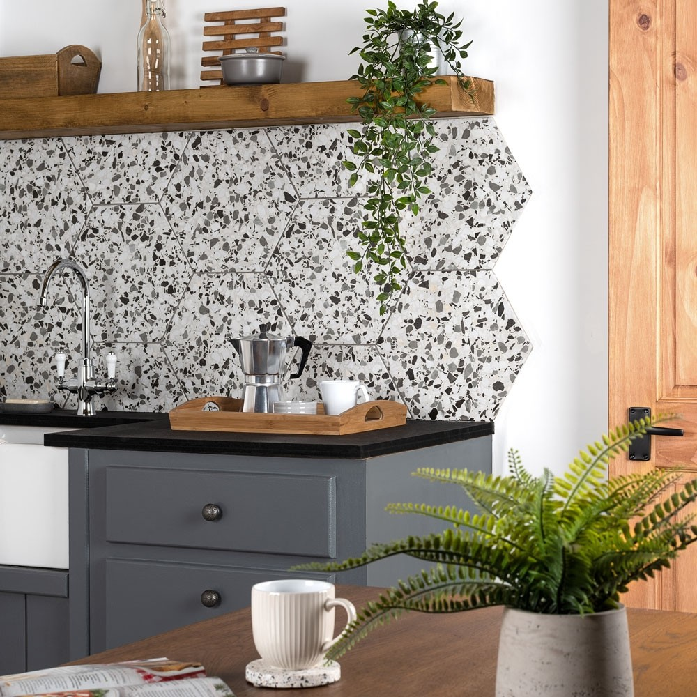 grey speckled hexagon tiles as a splashback in a kitchen