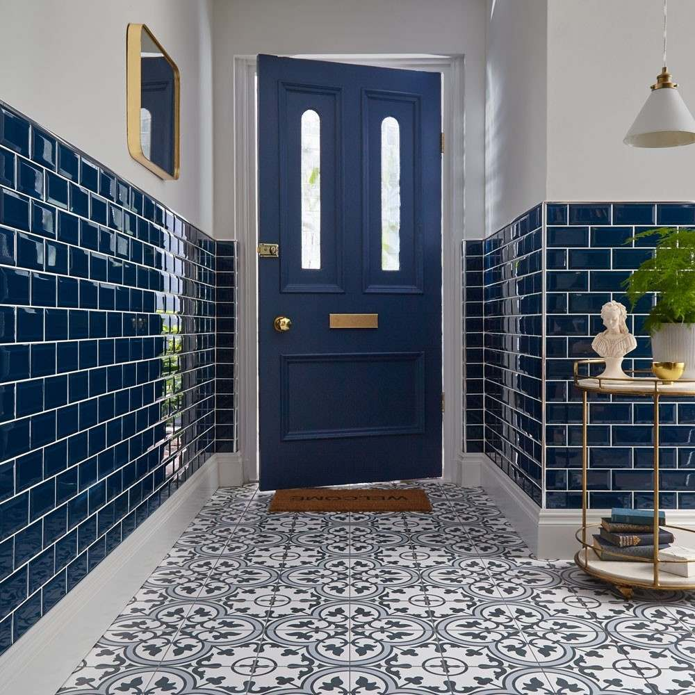 statement floor in blue with blue metro tiles on the walls