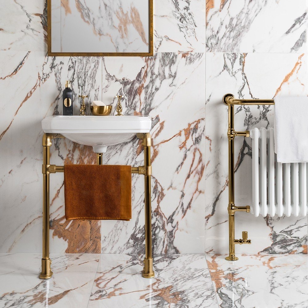 white and gold marble deluxe tiles in a bathroom with gold accents