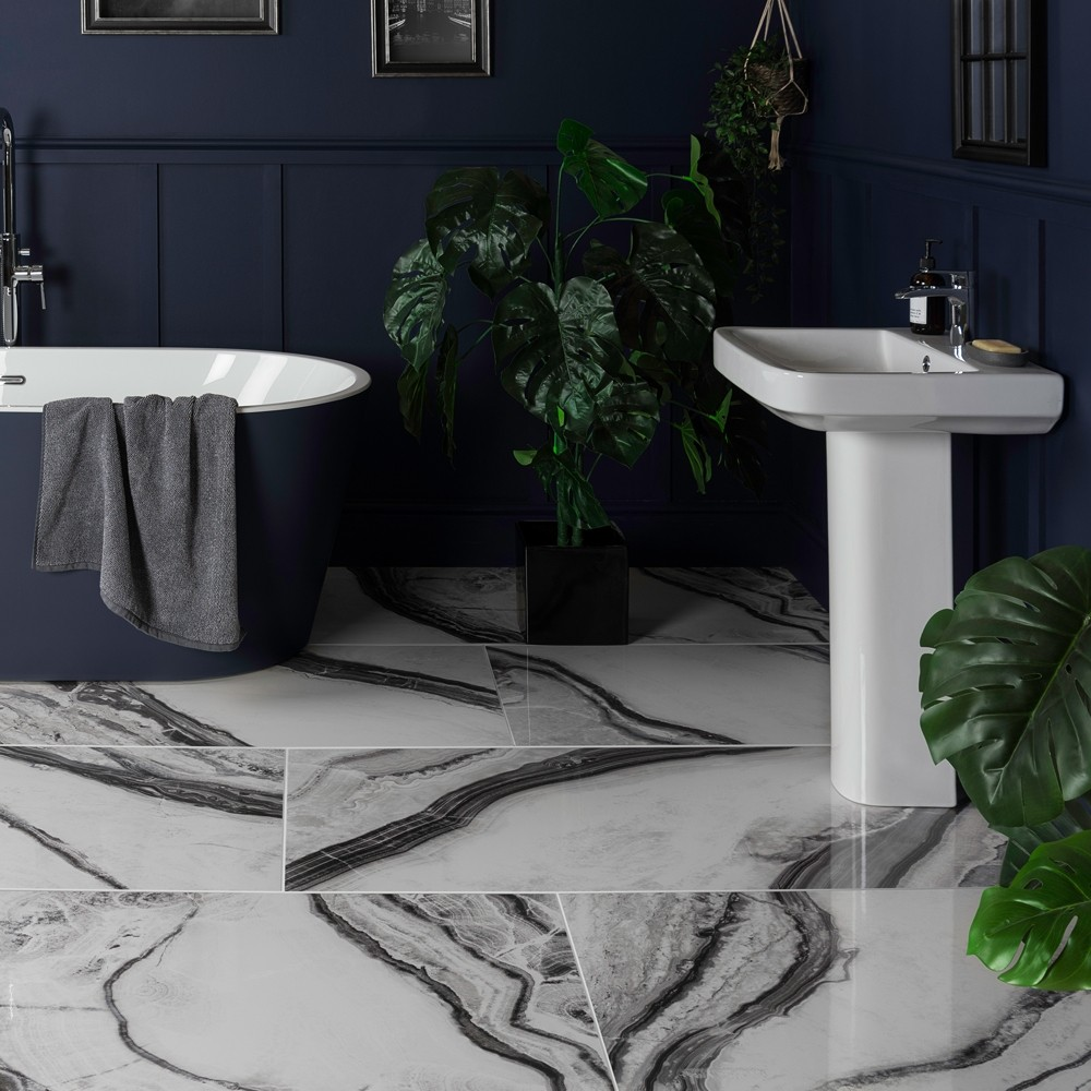black and white panda marble deluxe tiles in a navy coloured bathroom