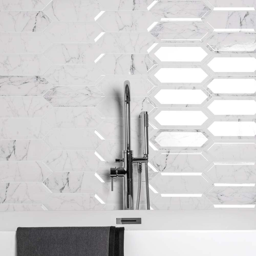 elongated marble effect tiles in a bathroom