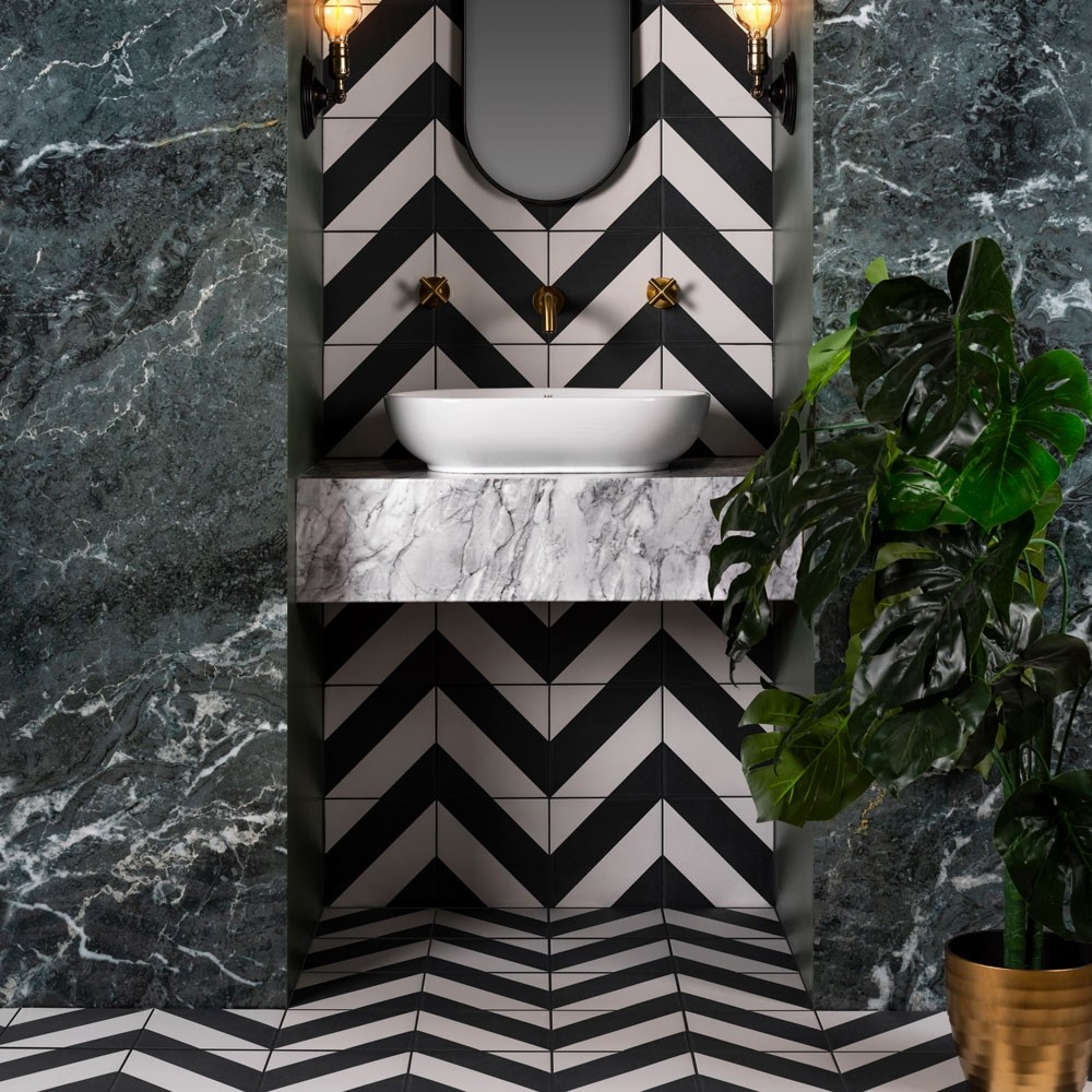 black and white zebra tiles in a chevron pattern on the walls and floors