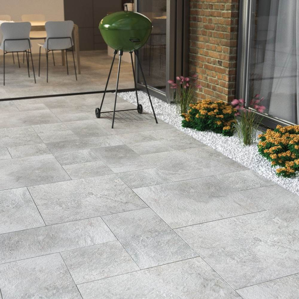 lakeside silver slate effect grey porcelain paving slabs with a bbq