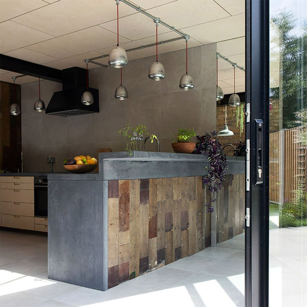 Industial style kitchen with trax grey mist stone effect porcelain paving slabs indoors outdoors look