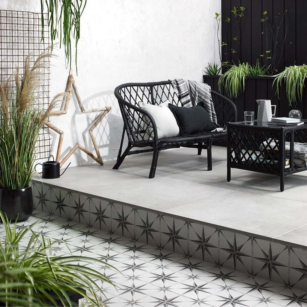 trax grey mist porcelain paving slabs and astral star black and white patterned tiles